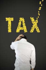 Businessman stress about tax.